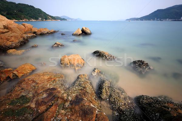 Costa rocha longa exposição água abstrato paisagem Foto stock © leungchopan
