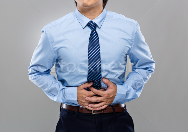 Businessman with stomachache Stock photo © leungchopan