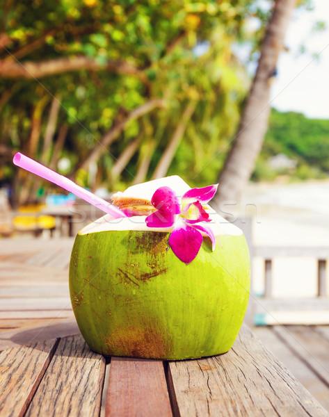 Coconut drink on table beside beach Stock photo © leungchopan