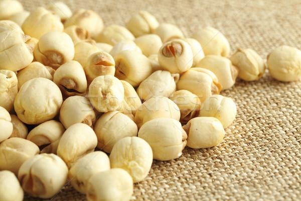 Lotus seed on the linen background Stock photo © leungchopan