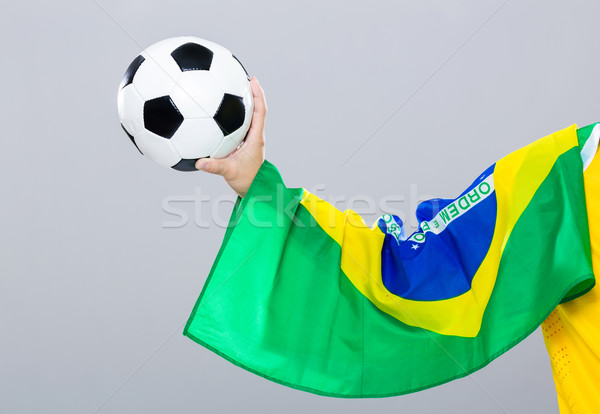 Hand scratch with football with brazil flag Stock photo © leungchopan