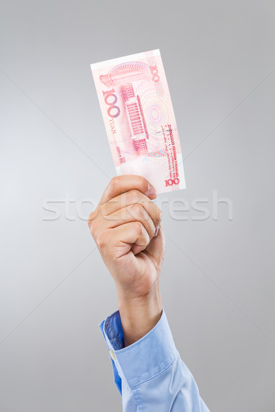 Businessman hand hold with hundred RMB Stock photo © leungchopan