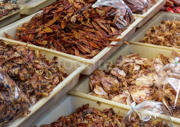 Dried squid in food market Stock photo © leungchopan