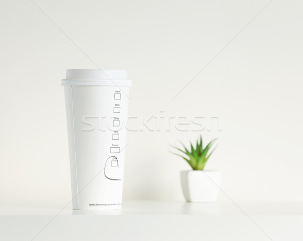 White coffe cup and green potted plant Stock photo © leungchopan
