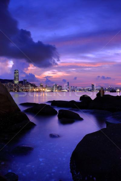 Hong Kong cena noturna céu escritório água pôr do sol Foto stock © leungchopan