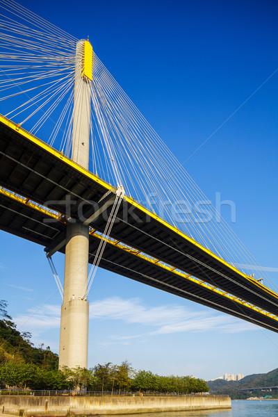 висячий мост морем моста синий Skyline облаке Сток-фото © leungchopan