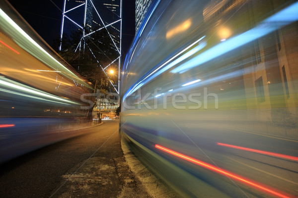 Bus speeding through night street. Hong Kong, China Stock photo © leungchopan