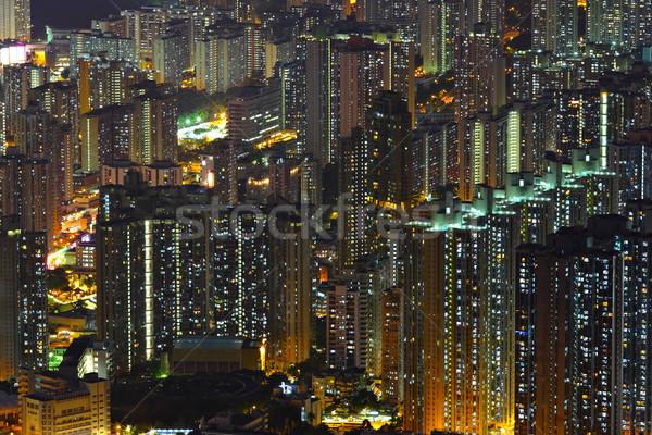Társasház éjszaka város fal otthon ablak Stock fotó © leungchopan