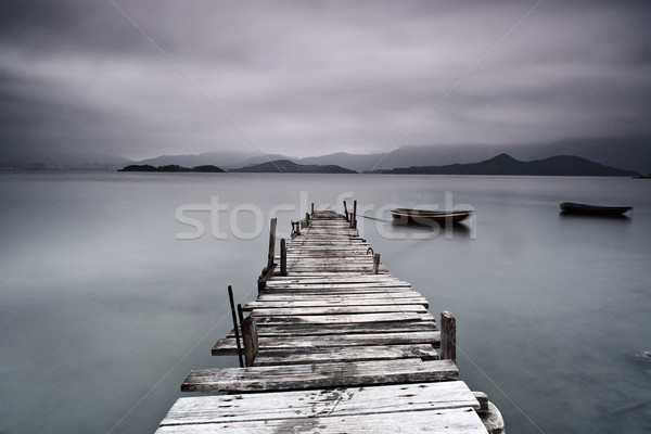 pier and boat, low saturation Stock photo © leungchopan