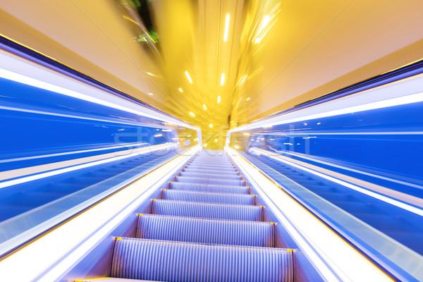 Movement of diminishing hallway escalator Stock photo © leungchopan