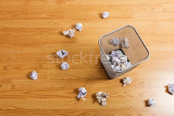 Metal basket and paper ball Stock photo © leungchopan
