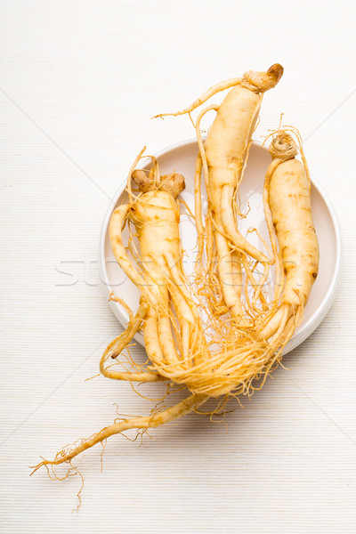 Fresh Ginseng over the white background Stock photo © leungchopan