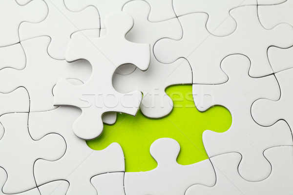 Puzzle with missing piece in green color Stock photo © leungchopan