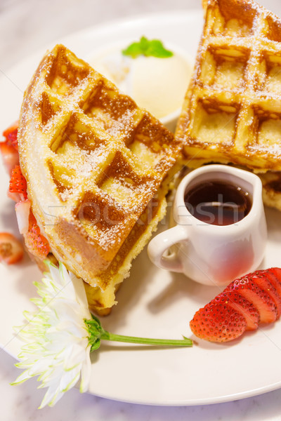 Baked waffles with syrup and strawberries Stock photo © leungchopan