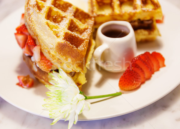 Waffles with syrup and strawberries Stock photo © leungchopan