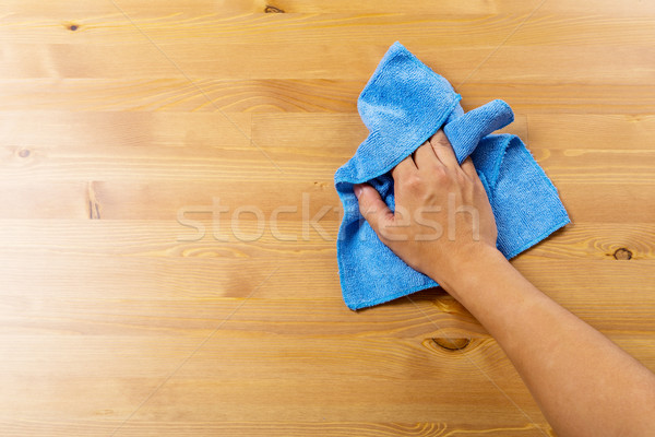 Cleaning table by blue rag Stock photo © leungchopan