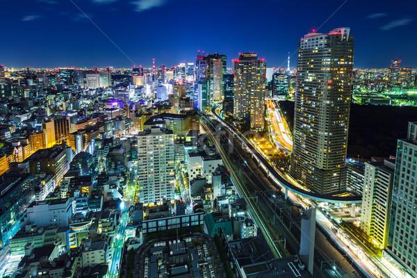 Tokió városkép éjszaka épületek városi fények Stock fotó © leungchopan
