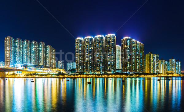 Apartment building at night in Hong Kong Stock photo © leungchopan
