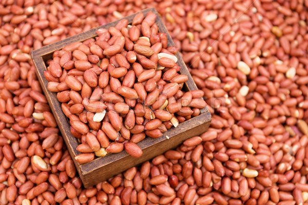 Peanut kernels with wooden container Stock photo © leungchopan