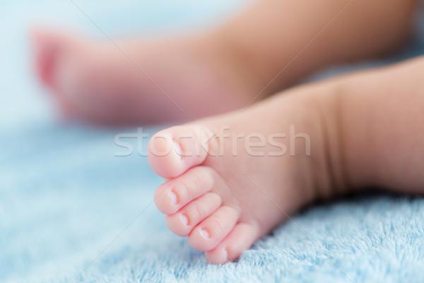 Küçücük bebek ayaklar doku mavi çocuk Stok fotoğraf © leungchopan