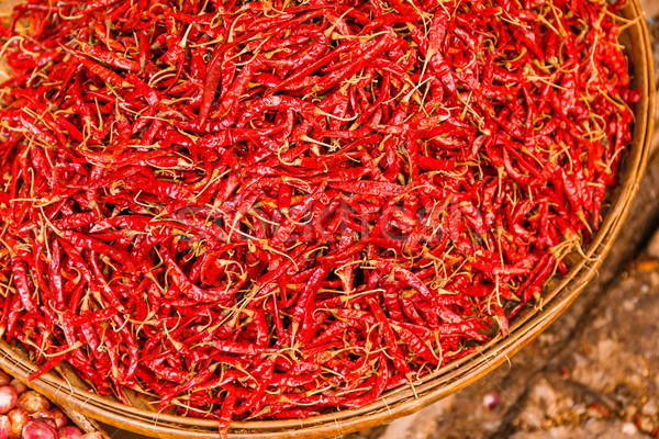 Stock photo: Preservation procedure of red Chili peppers on basket