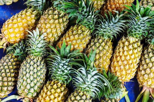 Pineapple pile Stock photo © leungchopan