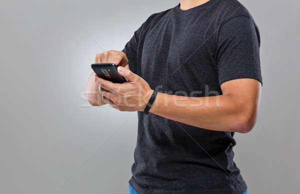 Man use mobile phone sync with activity tracker Stock photo © leungchopan