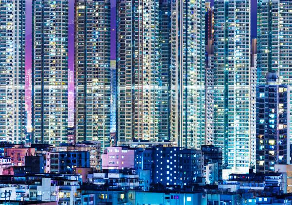 Overpopulated modern building in Hong Kong at night Stock photo © leungchopan