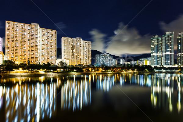 Nyilvános lakásügy Hongkong víz éjszaka sziluett Stock fotó © leungchopan