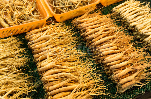 Ginseng for sell in food market Stock photo © leungchopan