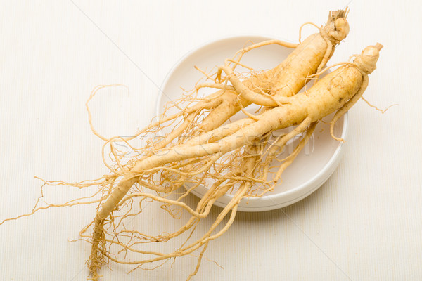 Ginseng on white background Stock photo © leungchopan