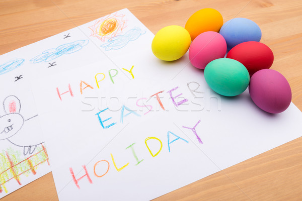 Painted easter egg and little kid drawing Stock photo © leungchopan