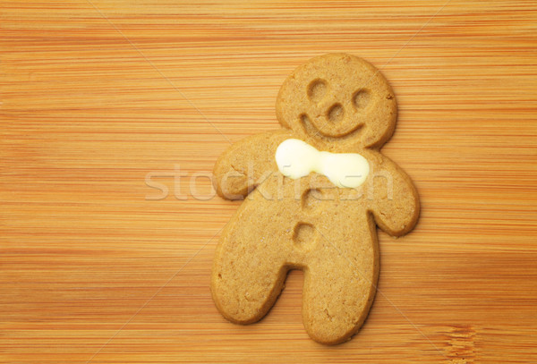 Gingerbread man cookie on wooden background Stock photo © leungchopan