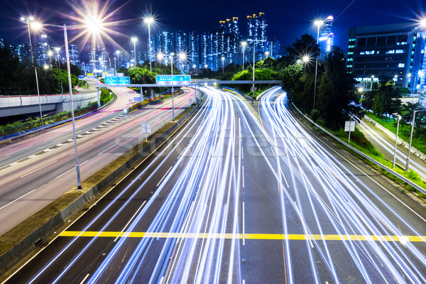 Busy traffic on highway at night Stock photo © leungchopan