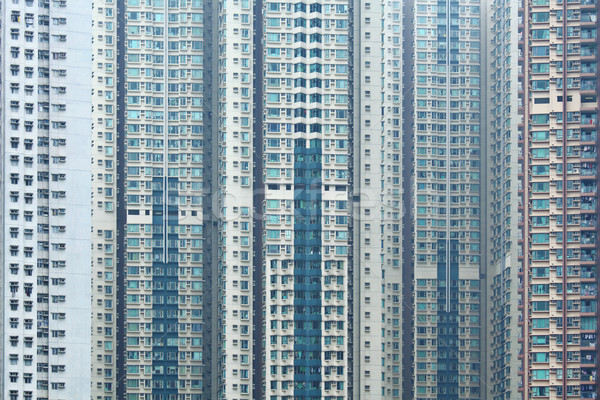 Overpopulated building in city Stock photo © leungchopan