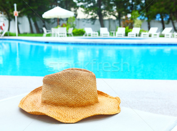 Swimming pool in resort Stock photo © leungchopan