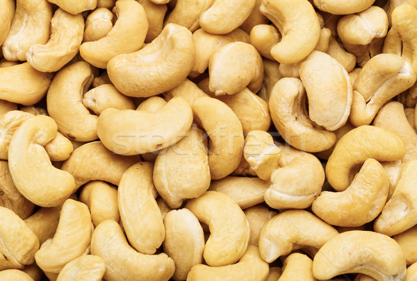 Fresh cashew nuts close up Stock photo © leungchopan
