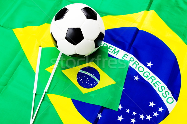 Brazilian flag and soccer ball Stock photo © leungchopan