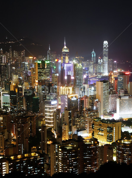 Hong Kong with crowded building at night Stock photo © leungchopan