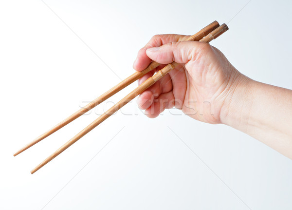 hand using chopsticks Stock photo © leungchopan