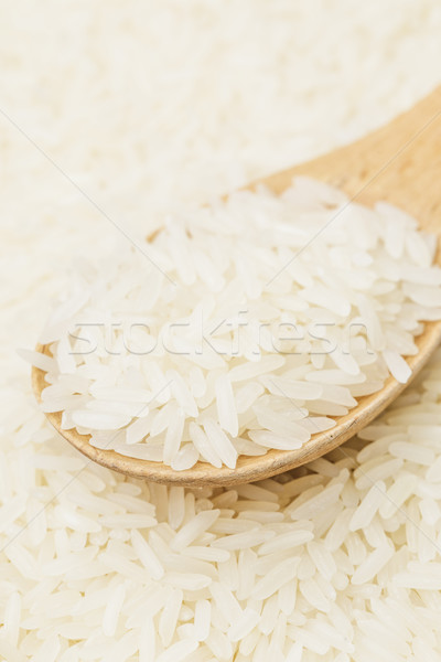 Uncooked white rice on spoon Stock photo © leungchopan