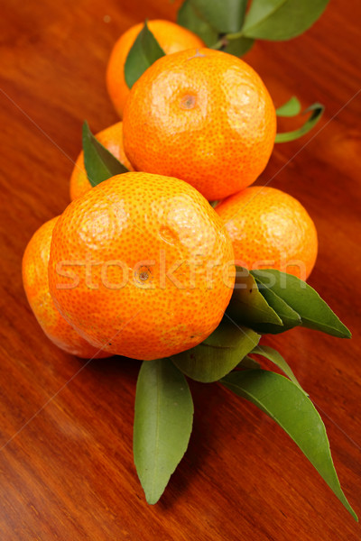 mandarin on wooden background Stock photo © leungchopan