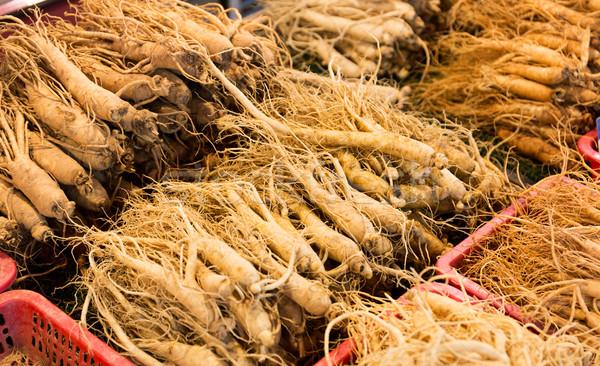 свежие женьшень продовольствие рынке Азии контейнера Сток-фото © leungchopan