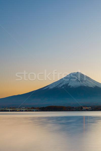 Montanha fuji pôr do sol neve lago planta Foto stock © leungchopan