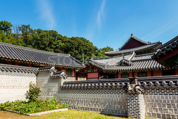 Traditional korean architecture with castle wall Stock photo © leungchopan