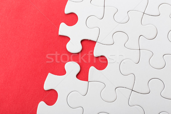 White puzzle on red background Stock photo © leungchopan