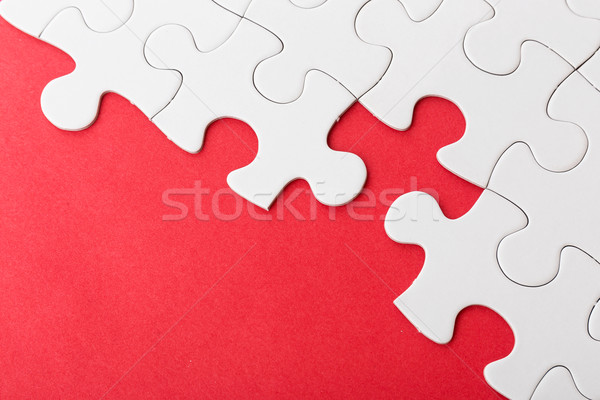 Incomplete puzzle over red background Stock photo © leungchopan
