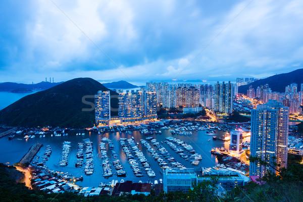 Társasház Hongkong égbolt épület naplemente utazás Stock fotó © leungchopan