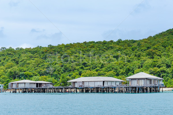 Wooden house with seascape Stock photo © leungchopan