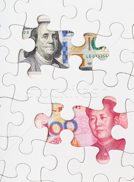 US dollar and chinese yuan with white puzzle Stock photo © leungchopan